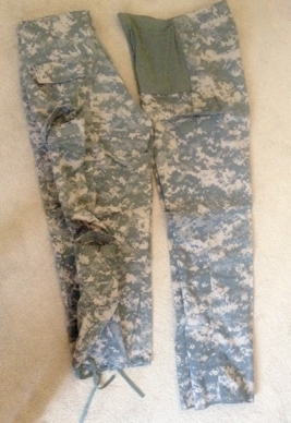 Regular ACU Trousers on the left, Maternity ACU Trousers on the right. Note the belly panel and single small pocket on the maternity pants. See all the pockets on the regular pants?