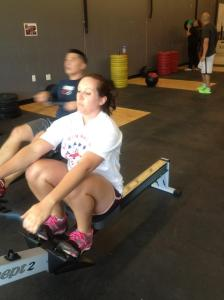 A 500m row before a series of 30 wall balls. Anna in the front, husband Kevin behind. (Photo by Jessica Schroeder, CrossFit Sandstorm Coach)